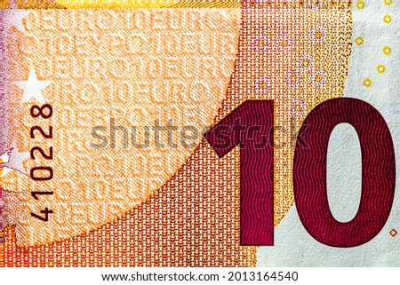 Selective focus on detail of EURO banknotes. Close up macro detail of EURO banknotes Royalty-Free Stock Photo #2013164540