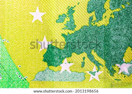 Selective focus on detail of EURO banknotes. Close up macro detail of EURO banknotes. World money concept, inflation and economy concept Royalty-Free Stock Photo #2013198656