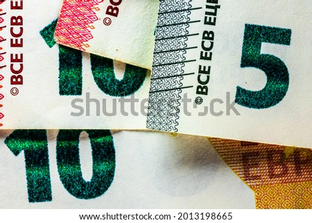 Selective focus on detail of EURO banknotes. Close up macro detail of EURO banknotes. World money concept, inflation and economy concept Royalty-Free Stock Photo #2013198665