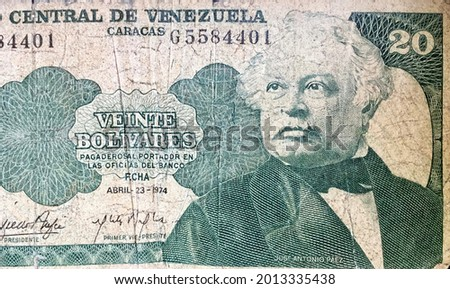 A close-up macro photo of a worn Venezuelan banknote of 20 bolivares printed in 1974. The banknote features a portrait of president of the republic in the 19th century Jose Antonio Paez. Royalty-Free Stock Photo #2013335438