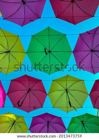 Low Angle View Of Colorful Umbrellas Hanging Outdoors - stock photo. High quality photo