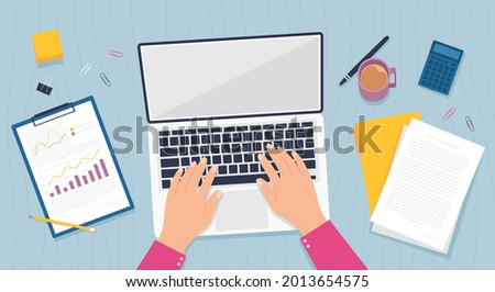 Desk top view. Office table with hands work on laptop computer, business document, papers and folder. Online job or education  concept. Freelancer or employee worker at workplace