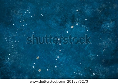 Astronomical Celestial pattern Constellation Scorpio from star shape silver confetti on the blue background