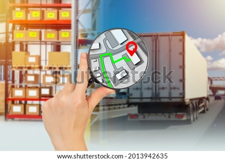 Logistic technology and transport. Logistics truck . Concept - development of logistics route. Track route on map. Route in magnifying glass. Hand of logistician with a magnifying glass. Royalty-Free Stock Photo #2013942635