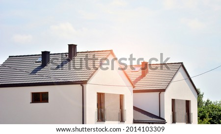 New single family house in a new development area. Residential home with modern facade.   Royalty-Free Stock Photo #2014103309