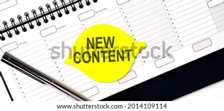 Text NEW CONTENT on yellow sticker on the planning