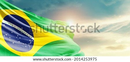 Brazil national flag waving in beautiful sky. Royalty-Free Stock Photo #2014253975