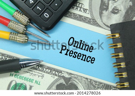 calculator, banknotes, arrows, notebook pens with the word online presence