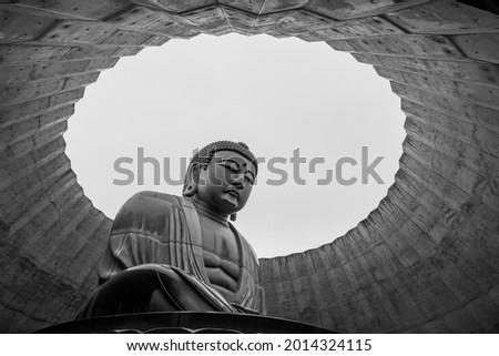 A landmark Buddha statue in Sapporo, Japan Royalty-Free Stock Photo #2014324115
