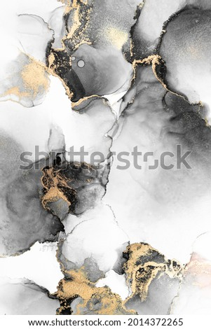 Black gold abstract background of marble liquid ink art painting on paper . Image of original artwork watercolor alcohol ink paint on high quality paper texture . Royalty-Free Stock Photo #2014372265