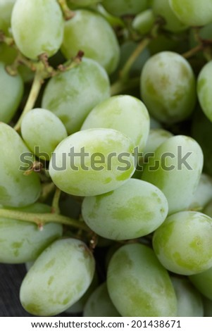 ripe green grapes on black wood table, close up #201438671