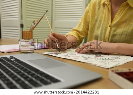 Woman drawing picture at online art lesson indoors, closeup. Distant learning