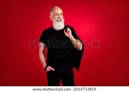 Photo of elderly man handsome happy positive smile curious look empty space isolated over red color background