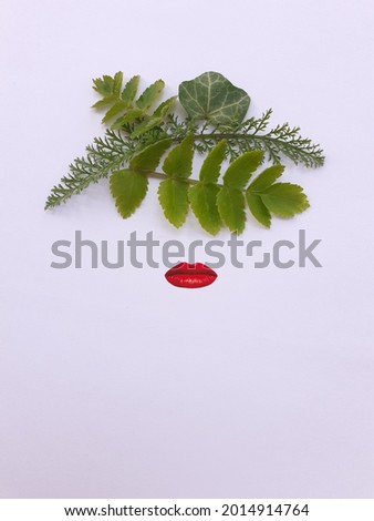 Flat lay photography. Frida Kahlo face abstract representation with leaves. Mexican artist painter. Abstract concept. Royalty-Free Stock Photo #2014914764