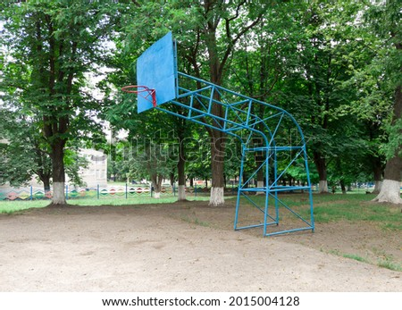 Old basketball board in a school court yard. basketball hoop for amateur sports. Old sport equipment.
