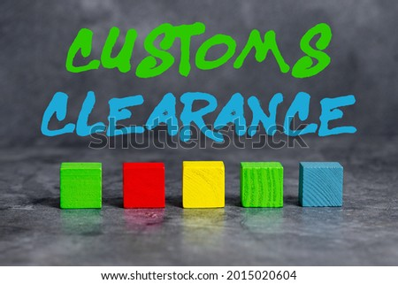Text caption presenting Customs Clearance. Conceptual photo documentations required to facilitate export or imports Stack of Sample Cube Rectangular Boxes On Surface Polished With Multi-Colour