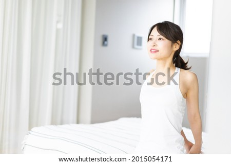 Young woman waking up refreshed Royalty-Free Stock Photo #2015054171