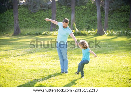 Enjoy every moment. Happy family enjoy summer outdoors. Playful father and son. Family fun Royalty-Free Stock Photo #2015132213