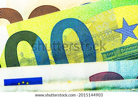 Selective focus on detail of EURO banknotes. Close up macro detail of EURO banknotes. World money concept, inflation and economy concept Royalty-Free Stock Photo #2015144903
