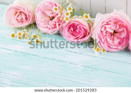 Fresh roses and chamomile on wooden background. Selective focus, horizontal.  #201529283