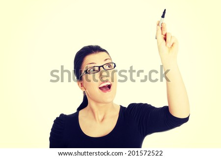 Young beautiful student woman writing with a pen on abstract screen #201572522