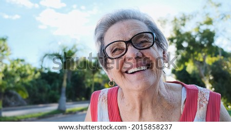 Smiling old Latin woman. Beautiful senior woman looking at the camera with a warm friendly smile and attentive expression. Elderly woman laughing. Royalty-Free Stock Photo #2015858237