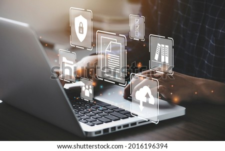 Businessman using a computer to document management concept, online documentation database and digital file storage system or software, records keeping, database technology, file access, doc sharing. Royalty-Free Stock Photo #2016196394