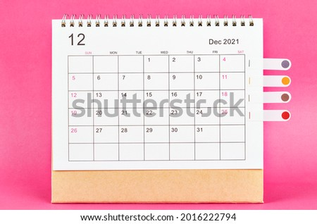 December 2021 calendar on pink background. Royalty-Free Stock Photo #2016222794
