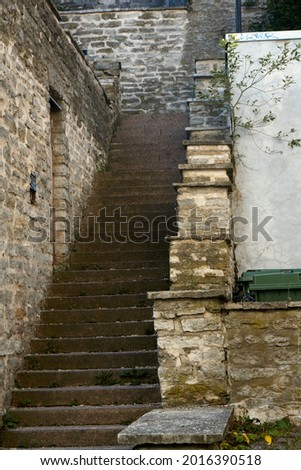 Old stone abandoned staircase in the city. High quality photo Royalty-Free Stock Photo #2016390518