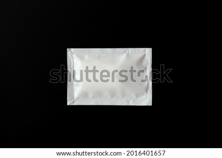 Blank white sachet packets stack mockup isolated on black background. Empty airtight pack mock-up for sauce, coffee, wet wipe, mayonnaise. Royalty-Free Stock Photo #2016401657