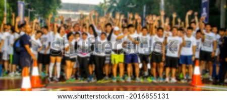 Abstract blurred photo of people prepare for running competition or marathon