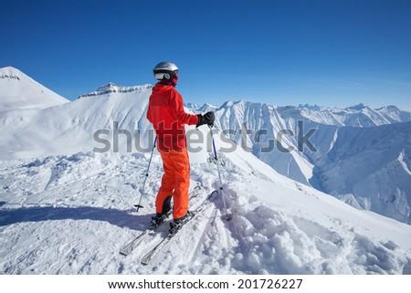 Skier is posing at camera at Gudauri resort in high mountaing of Georgia, Caucasus #201726227
