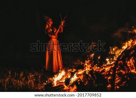 beautiful shamanic woman with headdress and deer skull. Royalty-Free Stock Photo #2017709852