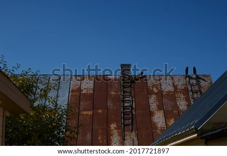 old roof of the house, on it a wooden staircase . High quality photo Royalty-Free Stock Photo #2017721897
