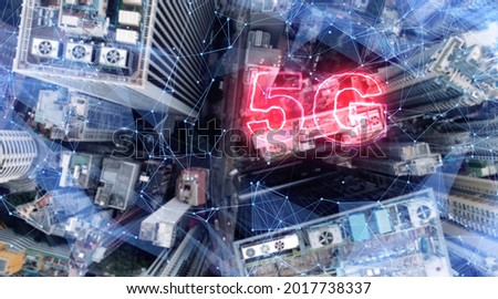 AERIAL. 5G network digital hologram on city background.5G network wireless systems. Royalty-Free Stock Photo #2017738337