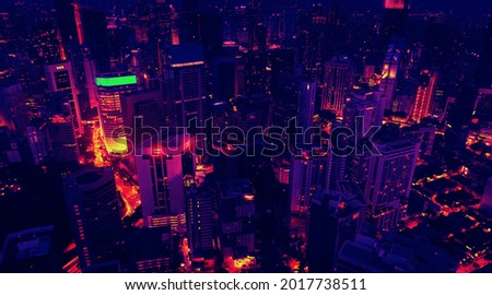 Aerial view of the skyscrapers of the city of Kuala Lumpur in the style of the 80s, neon colors. Wide shot  Royalty-Free Stock Photo #2017738511