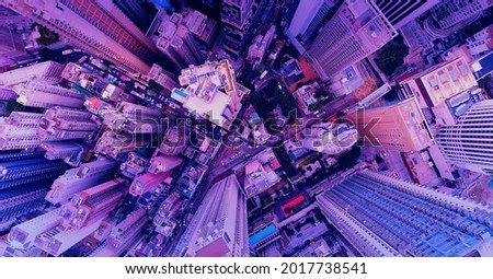 Aerial view of the skyscrapers of the city of Kuala Lumpur in the style of the 80s, neon colors. Wide shot  Royalty-Free Stock Photo #2017738541