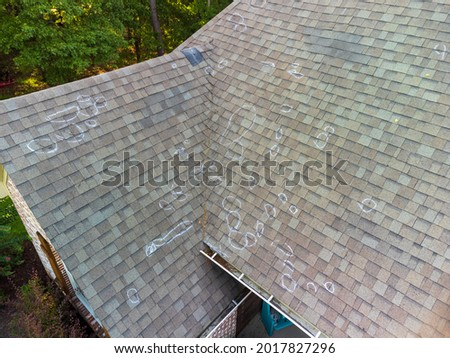 Roof with hail damage and chalk markings from inspection Royalty-Free Stock Photo #2017827296