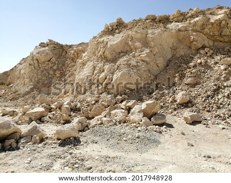Arid desert landscape in Sharjah emirate in the United Arab Emirates where the annual rainfall is less than 5 inches. Royalty-Free Stock Photo #2017948928