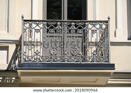 balcony of a historic building with a metal railing Royalty-Free Stock Photo #2018090966