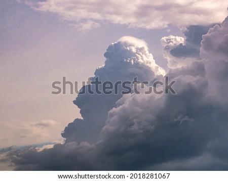 Massive and dark clouds Cumulus Congestus or Towering Cumulus rising high into the sky Royalty-Free Stock Photo #2018281067