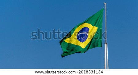 """Flag of Brazil fluttering in the wind. In the center of the flag with the words """"order and progress"""" in Portuguese Royalty-Free Stock Photo #2018331134"""