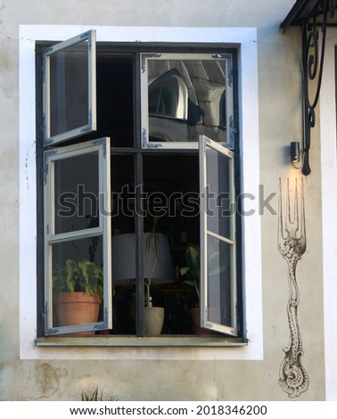 open window, flowers and a floor lamp inside . High quality photo Royalty-Free Stock Photo #2018346200