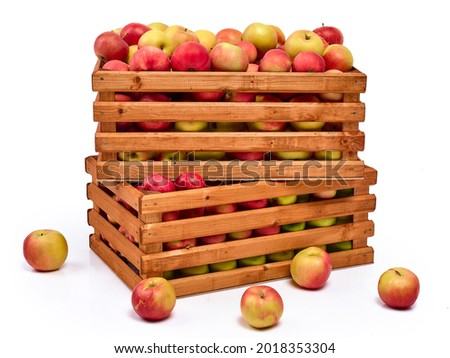 Fresh ripe yellow and red apples in wooden boxes, isolated on a white background Royalty-Free Stock Photo #2018353304
