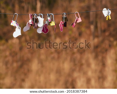 Padlock key with heart symbol of love on bridge - culture of love sign symbol background concept