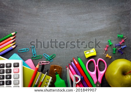 School supplies on blackboard background ready for your design Royalty-Free Stock Photo #201849907