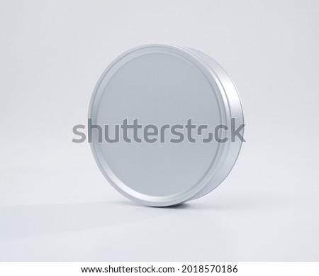 Metal box. Metal round tin with cover. Round metallic box on white background. High quality image Royalty-Free Stock Photo #2018570186