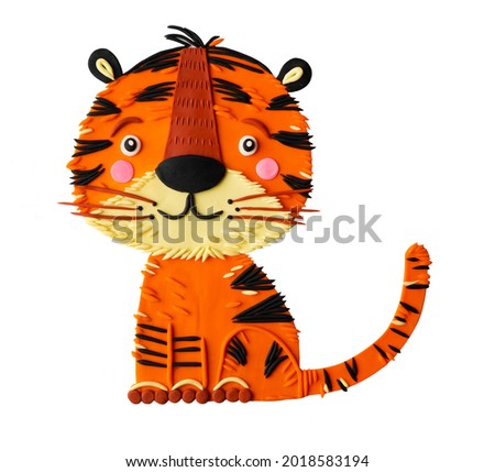 Cute cartoon plasticine clay tiger cub hand made childish craft. Chinese symbol of the year. Safari African striped wild cat.