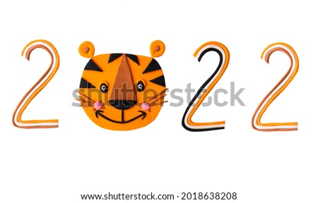 Cute cartoon tiger animal face handmade in clay plasticine with 3d effect. Safari predator wild cat of Africa. Asian Chinese new year symbol