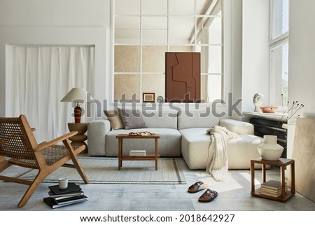 Creative composition of stylish and cozy living room interior with mock up structure painting, grey corner sofa, window, armchair and personal accessories. Beige neutral colors. Template. Royalty-Free Stock Photo #2018642927